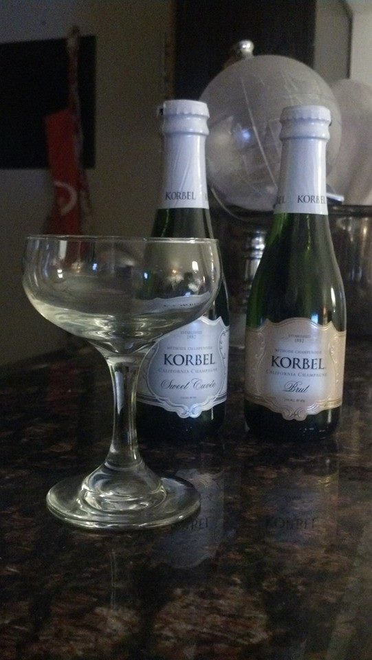 Pictured: two single-serve bottles of Korbel California champagne.