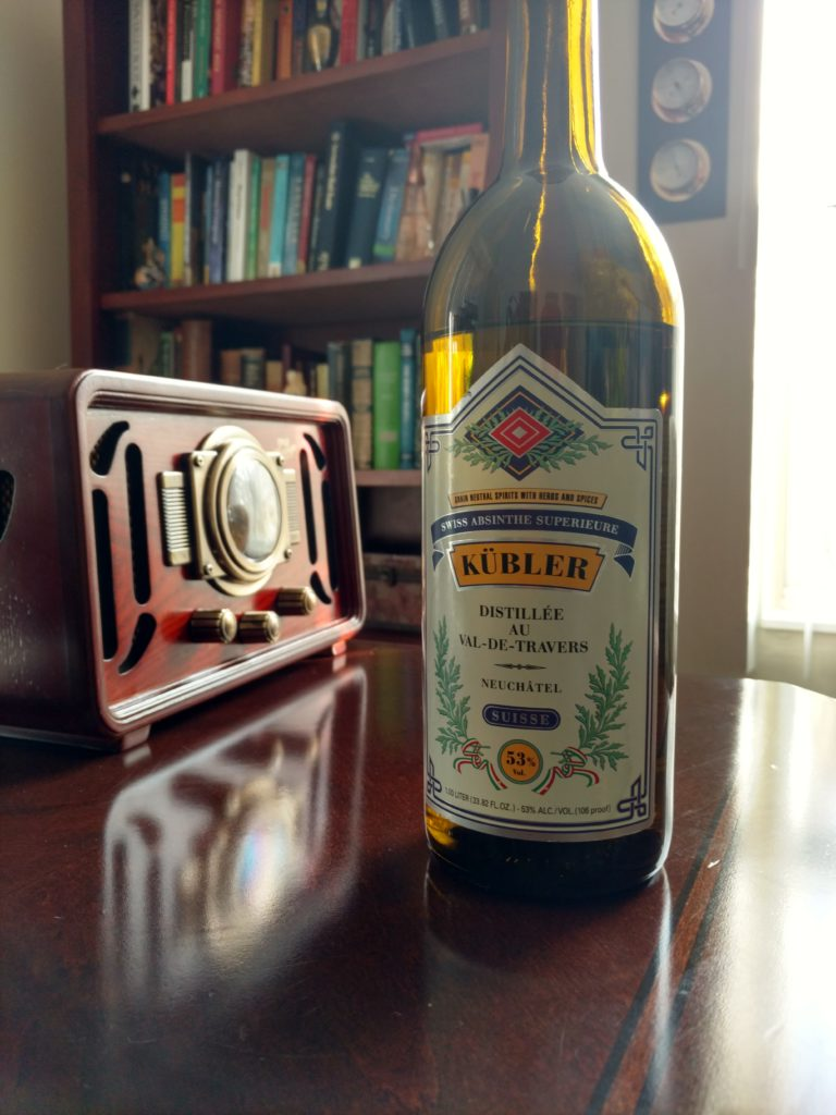 Pictured: Bottle of Kübler Absinthe Superieure absinthe on a desk.