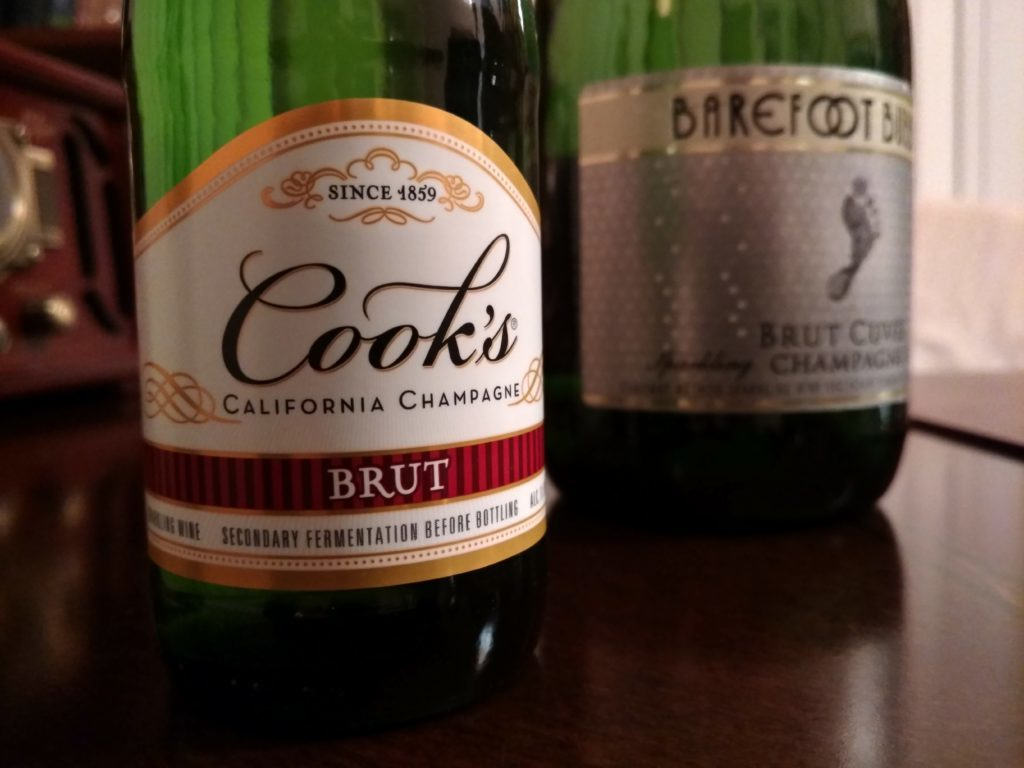 Pictured: a Cook's bottle and a Barefoot bottle, both of which bear California Champagne on their title.